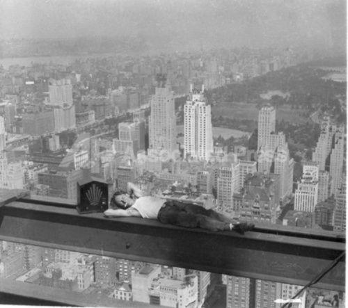 Charles Ebbets, Rockefeller Center construction worker listening to the radio on his break, 1932