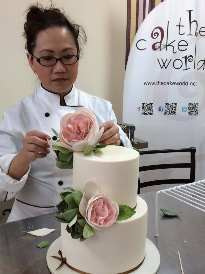 Sugar Queen - Patricia Hardjopranoto of Yummy Cupcakes & Cakes, love her clean classic modern cakes