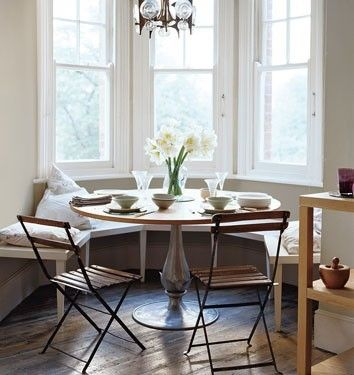 Harriet Maxwell Macdonald Sweet Cottage Bay Windows Dining Nook Design With  Built In Wood Bench, Round Wood Dining Room Table With Metal Base, Wood  Slatted ...