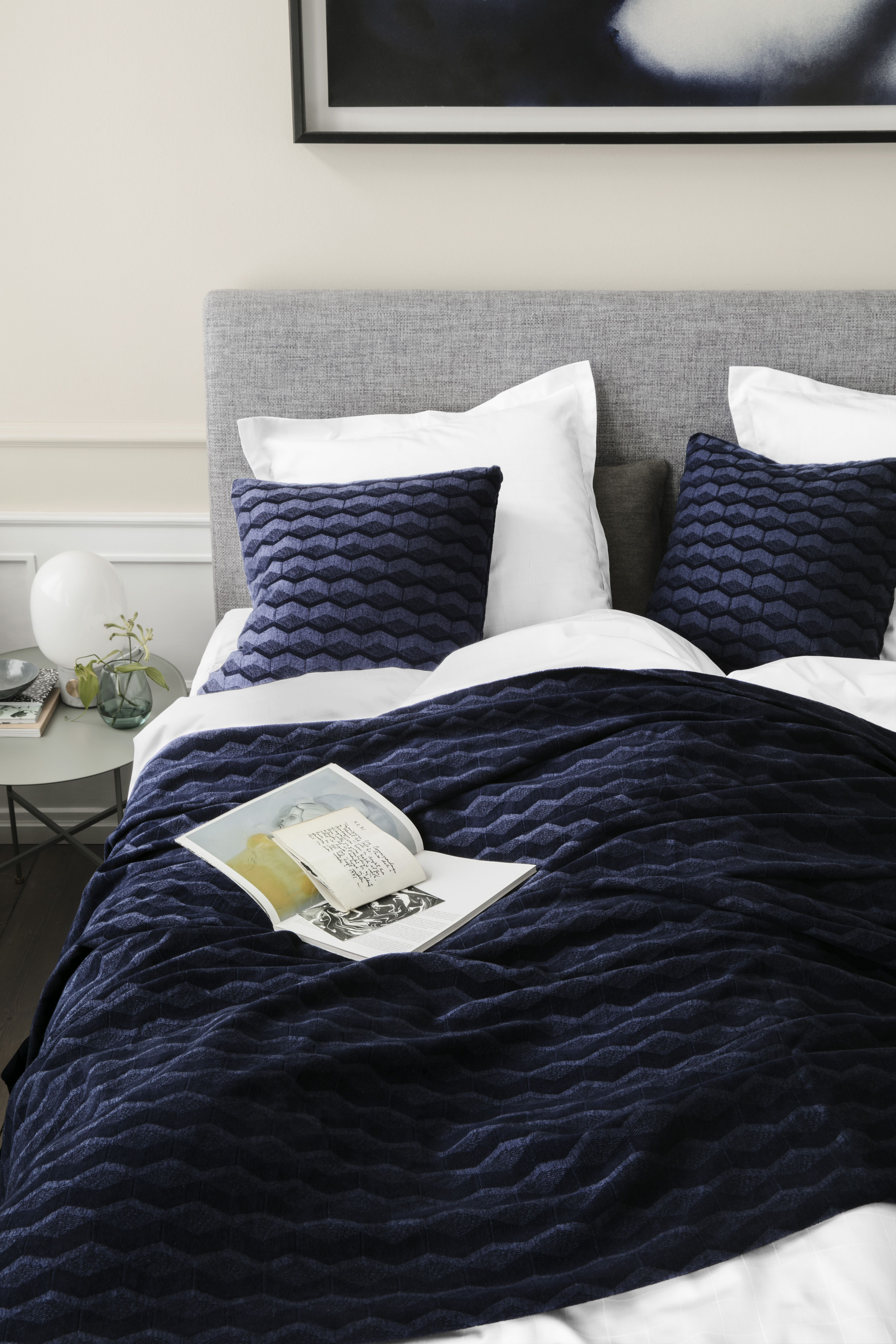 A graphic bedspread based on a proud design tradition the combination of cotton and viscose