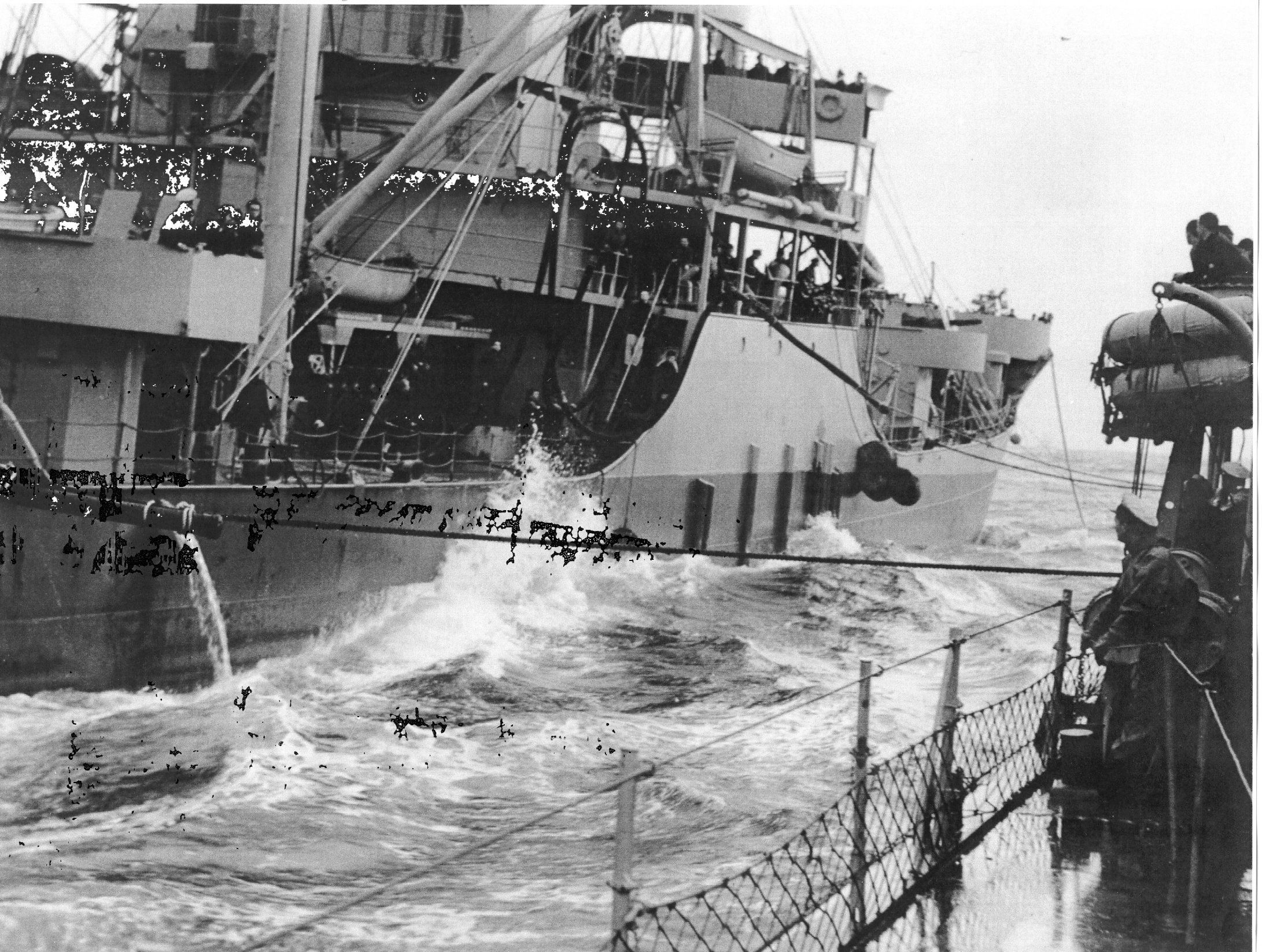 USS Housatonic (AO 35) refueling USS Wilkes (DD 441)