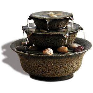 A small indoor fountain fits perfectly with a water garden. It adds ...