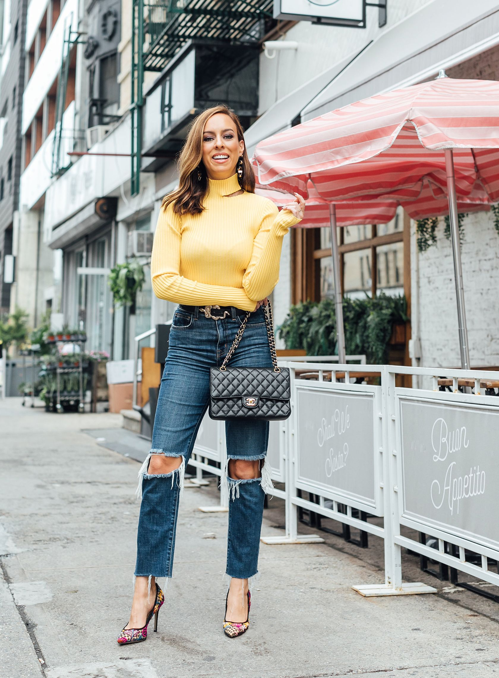 f0a590ab64aa4 Sydne Style shows casual outfit ideas with yellow sweater and ripped denim  #yellow #sweater #cutouts #jeans #chanelbag @sydnesummer