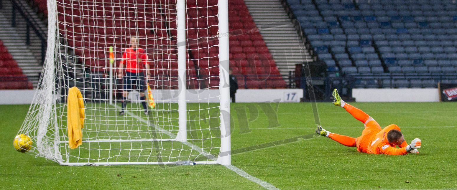 Cowdenbeath's keeper Grant Adam can't stop Chris Duggan's penalty during the SPFL League One play off game between Queen's Park and Cowdenbeath.