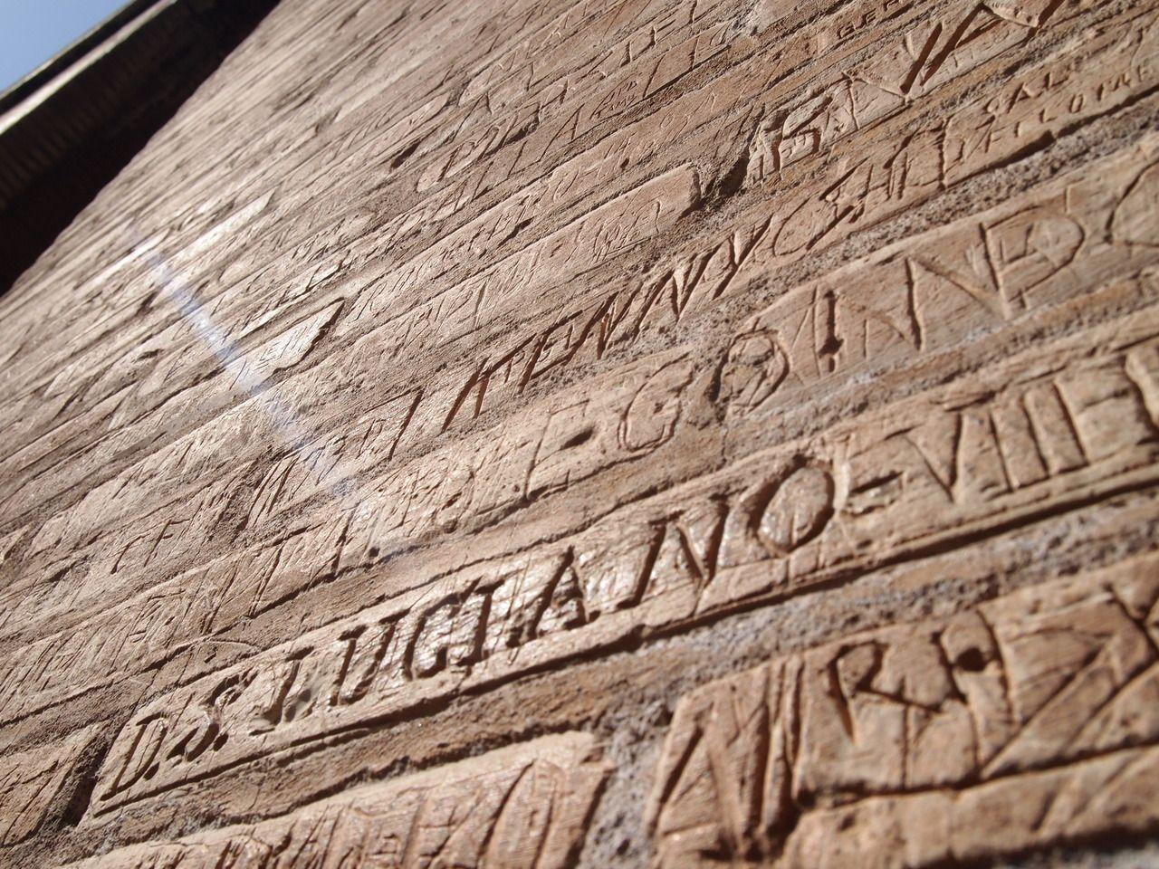 Ancient roman graffiti inscribed on the colosseum