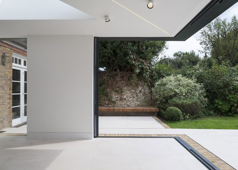 Interesting Home Extension In London Featuring Brick Walls And Sliding Glass Doors Freshome Com House Extensions Sliding Glass Door House Exterior