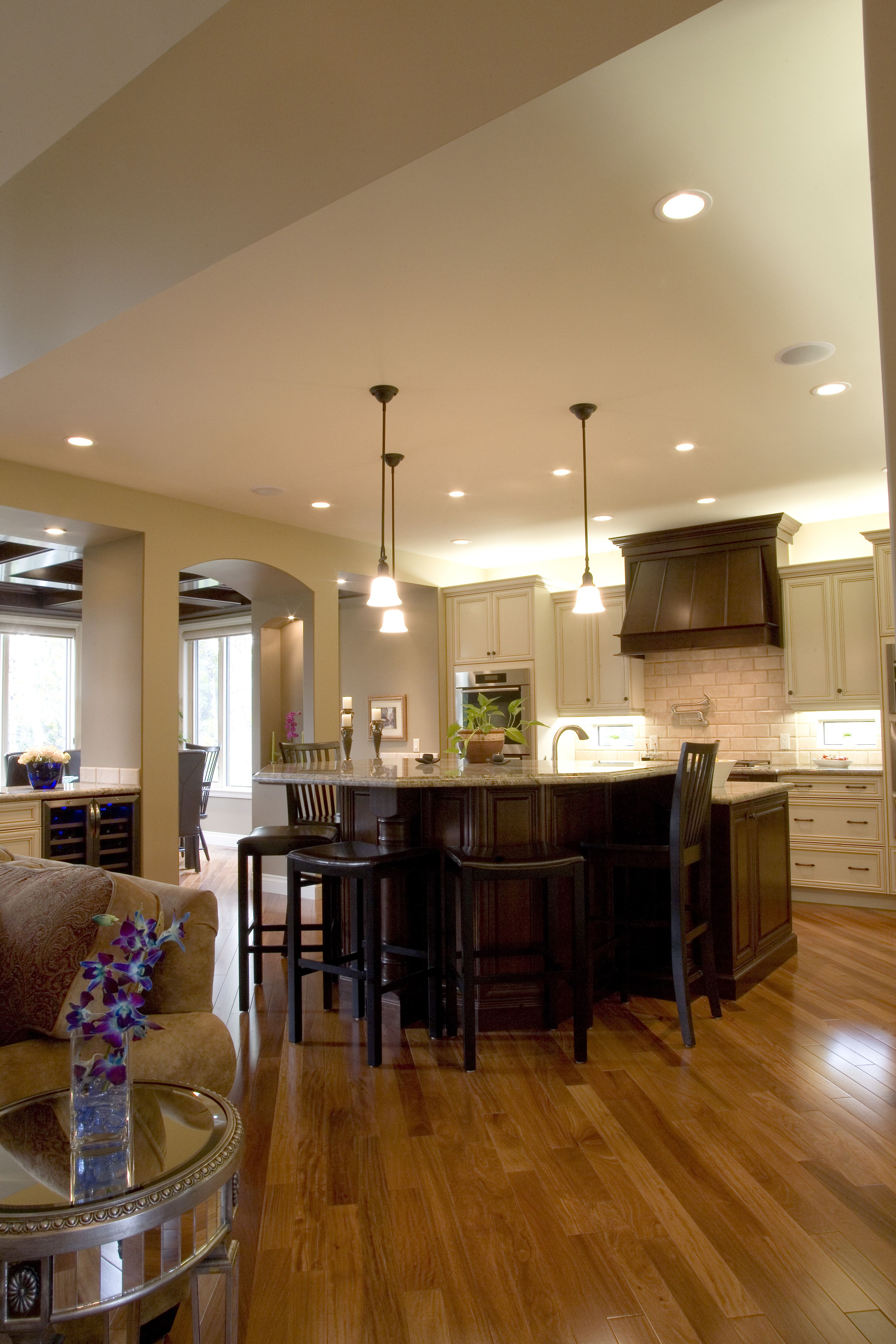 Granite Countertops Surface Twin Finish Maple Cabinetry With A Cappuccino  Stained Island And Range Hood Alongside