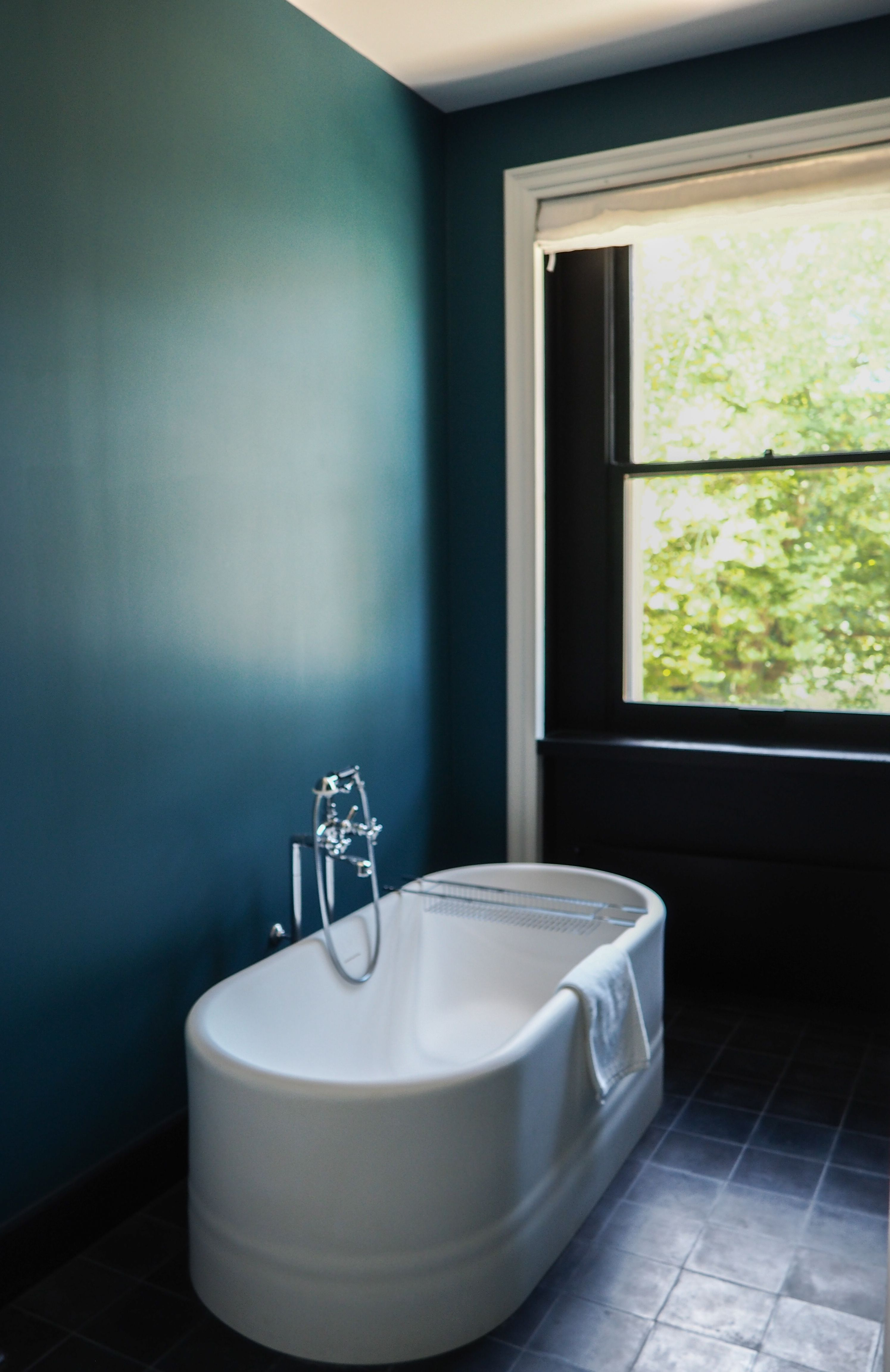 dark bathroom for a seaside house in brittany teal walls