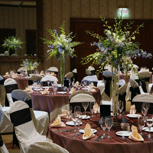Centerpieces containing green and white dendrobium orchids