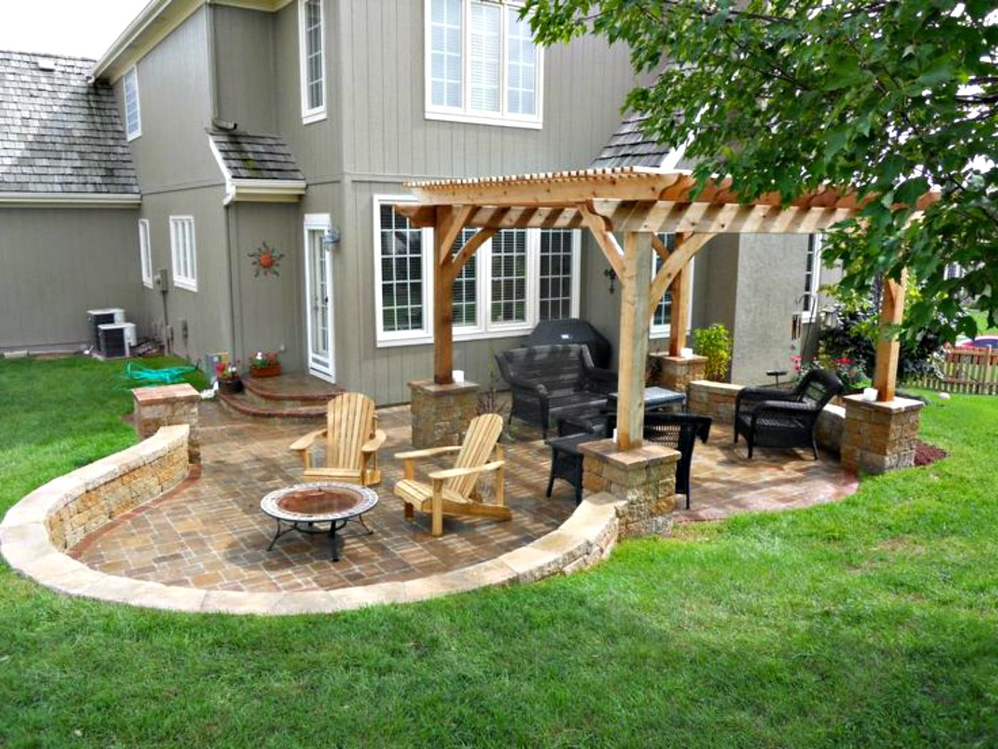 patio design with curved retaining wall and cedar pergola on backyard landscaping ideas with minimum budget id=87397