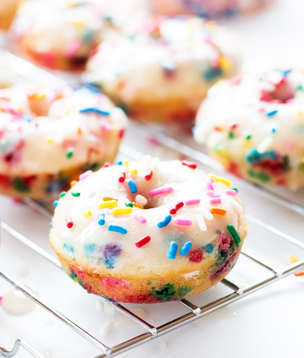 Birthday donuts are filled with funfetti sprinkles and topped with a sugary glaze. | www.ifyougiveablondeakitchen.com #TriplePFeature