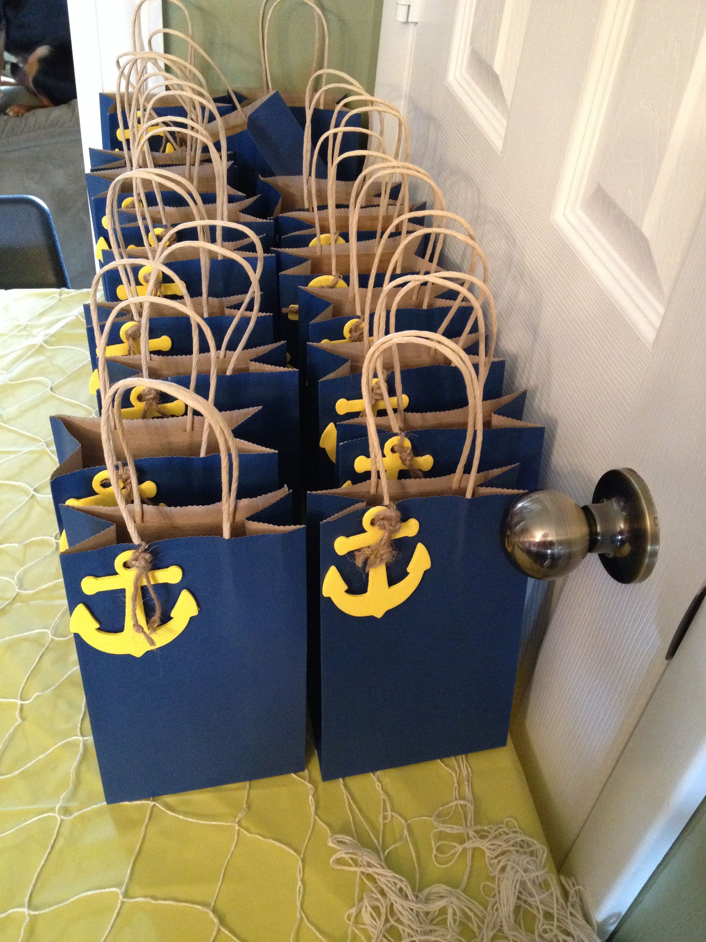 Found these wooden anchors & twine at Michaels Craft Store.  Painted anchors yellow and tied twine like rope knot. Jake pirate colored goody bags. Found 3-pack bags at Dollar Tree store. The kids loaded up on Pirate Grub after the party and brought around to all the Treasure Map Game stations.