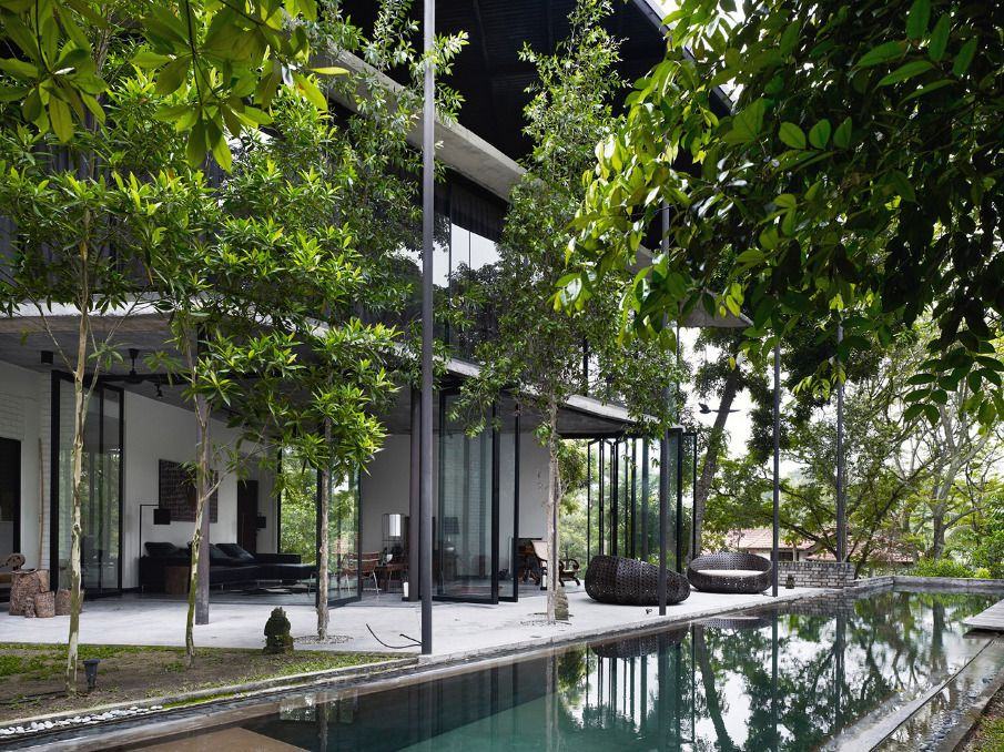Kevin low s dog concrete house in kuala lumpur malaysia for Architecture design malaysia house