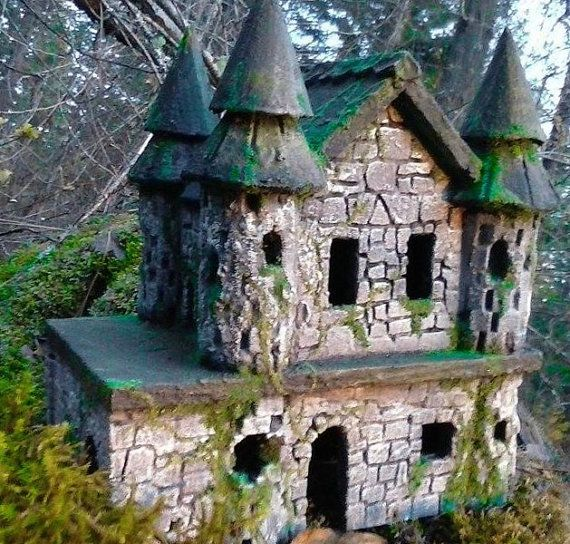 Faux STONE FAIRY CASTLE  Fairy Castle  Fairy House  Fairy Garden Castle Ruin Miniatures or Fairy Gardens Fairy Garden Accessories is part of Fairy garden Castle - In days of yore this FAIRYS STONE CASTLE was alive and bustling with Fae life  Fairy Kings and Queens graced the grand ballrooms and grounds of this Fae estate  But alas, a horrible tribe of trolls took over the forest  They were so gross and nasty that they made life miserable for all the gentle folk and forced all the fae folk to flee   Now the ballroom has grown quiet and the grounds overgrown    Moss and ivy grow on the walls and roof and a few of the stones have begun to fall away from the once regal castle walls   The forest is no longer infested with Trolls, but the Fae Folk will not come back  This castle may be in disrepair, but The Misty Hollow Pixie Restoration Society has made it sound and capable for relocation  It will be an excellent addition to any lucky persons garden and once located away from the trolls, the Pixies will come   This ONE OF A KIND creation is beautiful and mystical all at the same time  Made of mortar and carved eps foam, it is lite and easy to transport  It is also weather resistant  The bottom floor is open making it possible for you to assist any fairy in moving in their belongings if you like   The Castle measures aproximately 13 inches long x 8 inches wide and 12 inches tall  It has a 16 square inch balcony on the second floor for dances, picnics or just enjoying the evening breeze   Open doors and windows allow nice air circulation so the grand rooms don't get stuffy  PLEASE NOTE The stones look very real, but please remember that they are NOT SOLID STONE!  It is made of styrofoam which is covered with mortar and  FOAM COAT   which makes it sturdy, weather resistant and lightweight at the same time  Therefore I would caution the Fairies on their guest lists  Not that they would, but be sure they don't let fat old trolls come to any shindigs  They are far too rough on the furniture and they break everything  They are why we have the saying,  And THIS is why we can't have anything nice!  NOTE Kitty NOT INCLUDED  Used to convey scale only  ALSO PLEASE NOTE The castle pictured has sold, BUT with the pixie's magic, they are able to reproduce castles very similar to the one pictured  If you would like some custom alterations, please send a convo  to the seller and she will work with you on your specifications  THANK YOU EVER SO MUCH