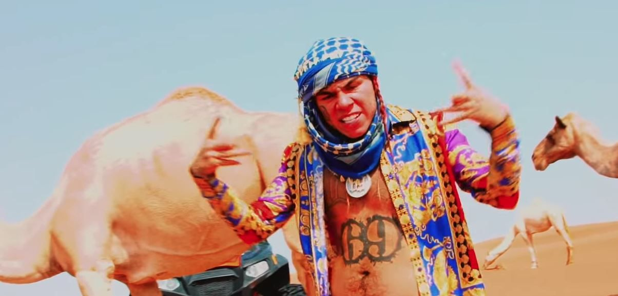 Watch 6ix9ine ride through the desert in a dune buggy