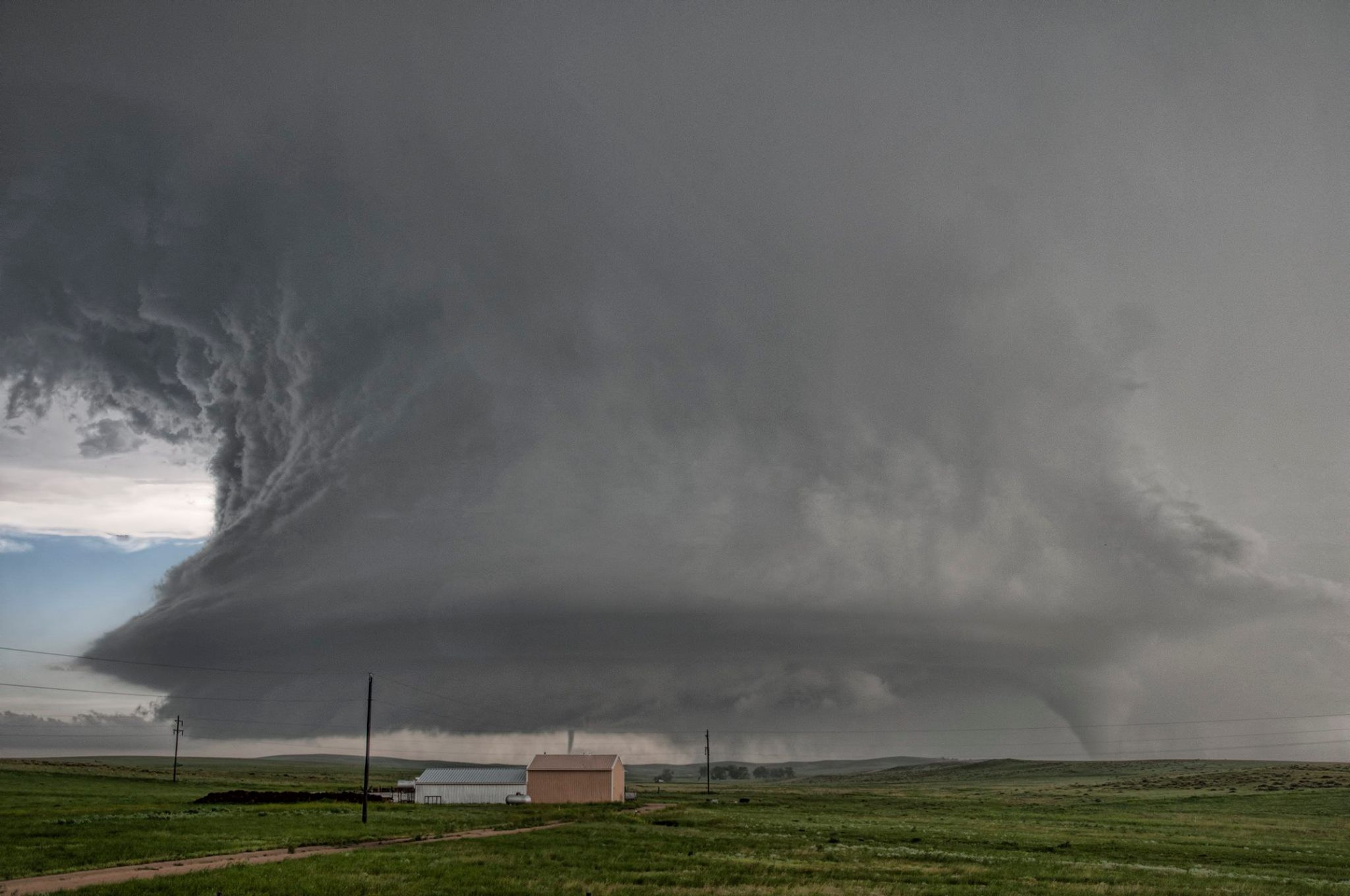 The great Simla supercell 4th June 2015. Satellite tornado is just behind the peach coloured building!