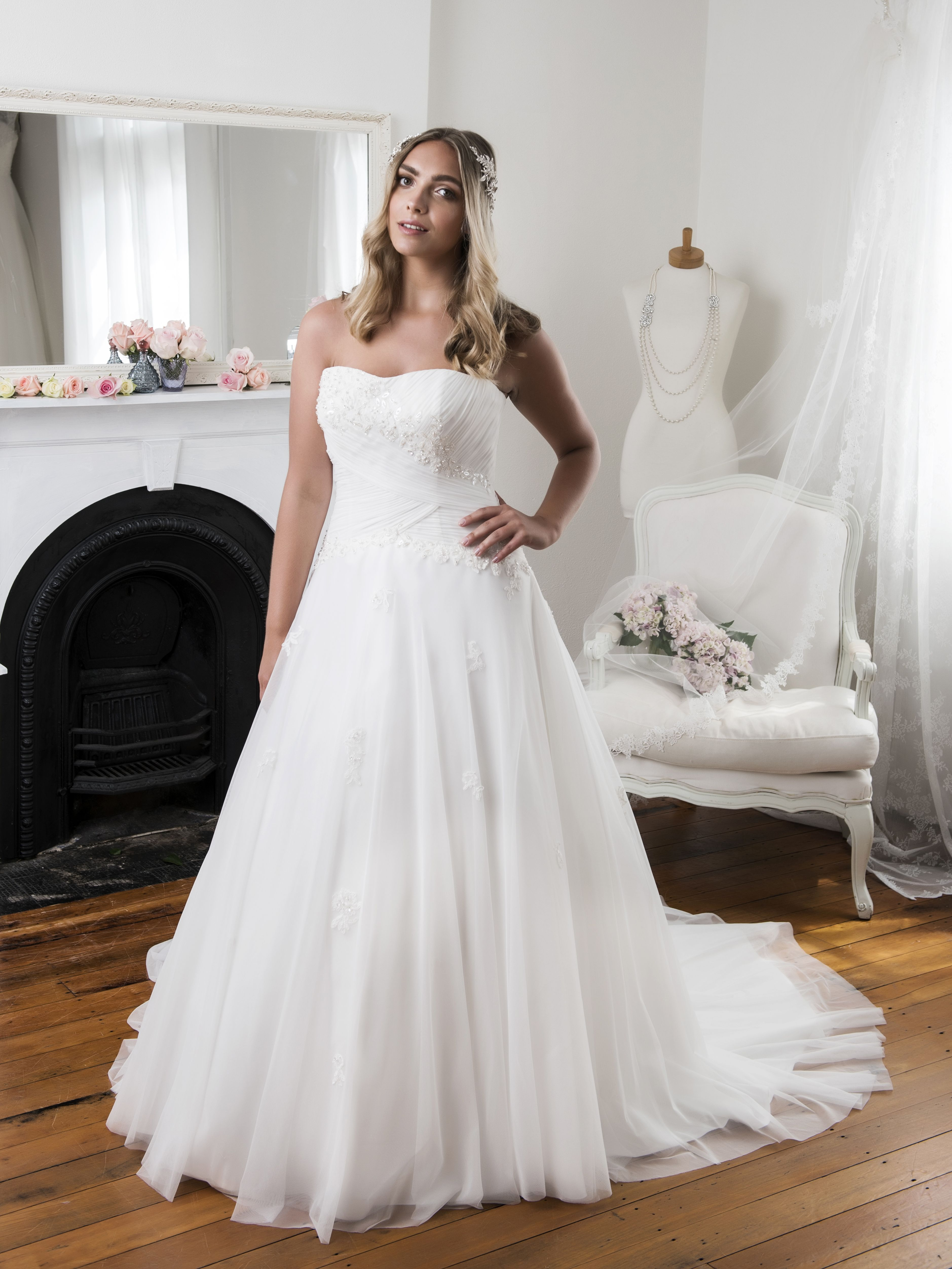Less is more, this elegant gown features a full skirt and stunning ...