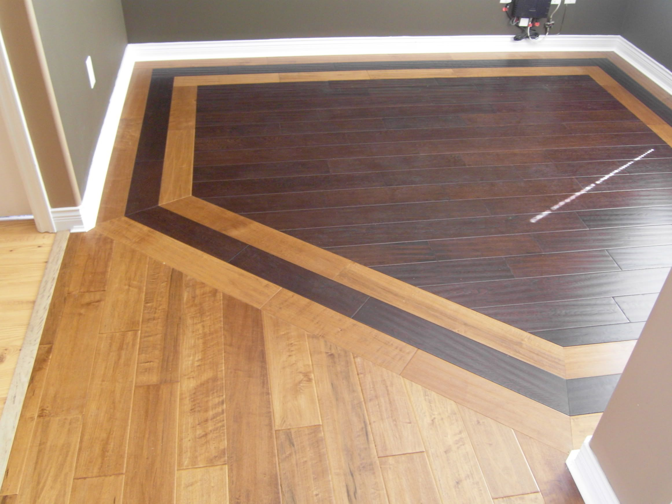 Hardwood border design idea for combining two different Hardwood floor designs borders