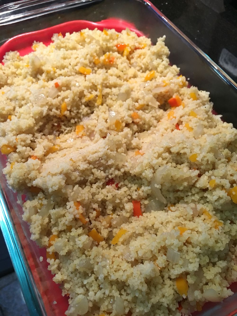 Moroccan couscous. There is no saffron or raisins added to this morracan dish