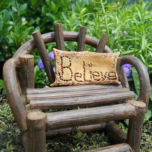 Fantail Bench. www.teeliesfairygarden.com . . .Calling all fairies and gnomes to take a sit and be enchanted with this fantail bench. It features a woodsy charm and a beautiful Believe pillow. #fairychair