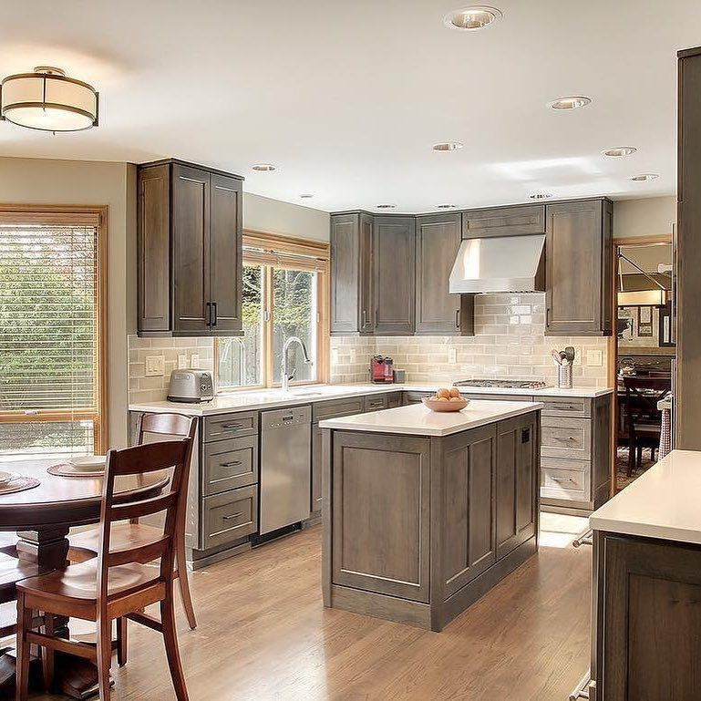 gorgeous warm gray stained kitchen cabinets with stainless appliances stained kitchen on kitchen decor grey cabinets id=28641