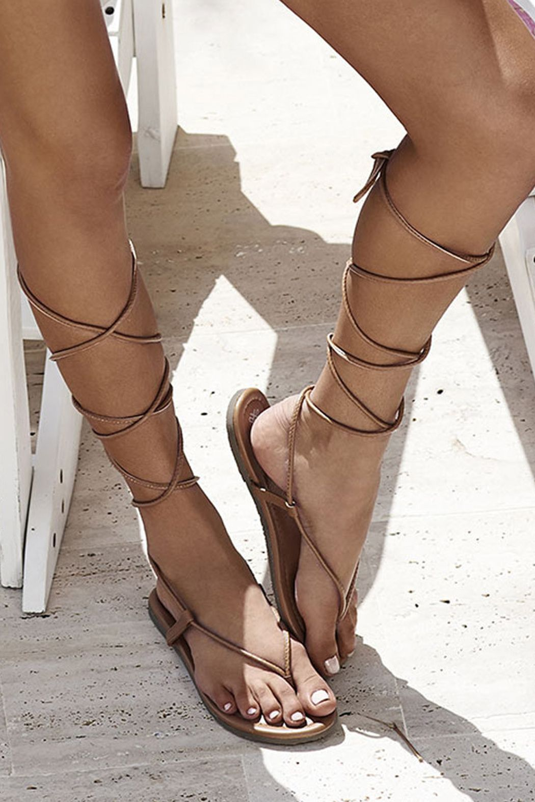6ef7d5402968 Tan Gladiator Sandal - Flat sandal. Long strings wrap around the legs and  tie just below the knee. Boutique Mango Molli Swimwear