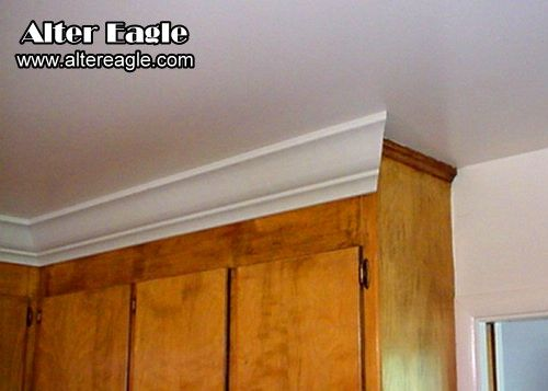 Installing crown molding above kitchen cabinets kitchen for Attaching crown molding to kitchen cabinets