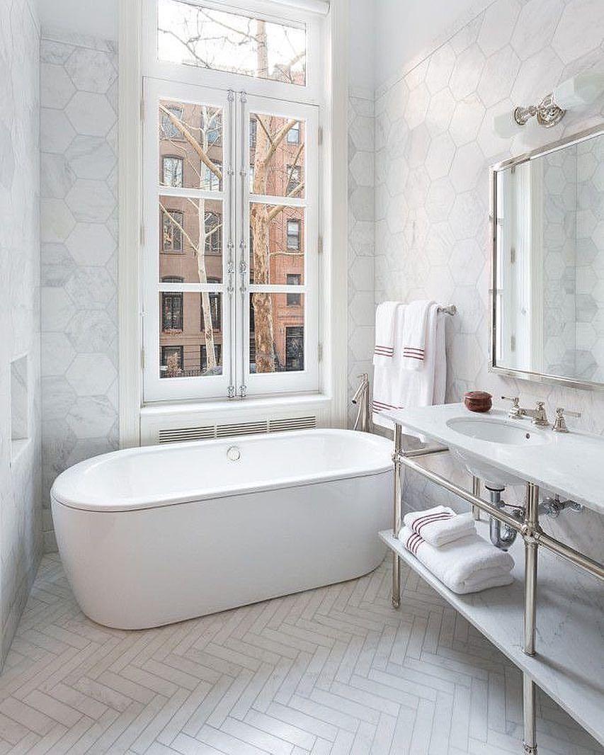 Beautiful bathroom with Carrara marble herringbone. I like the ...