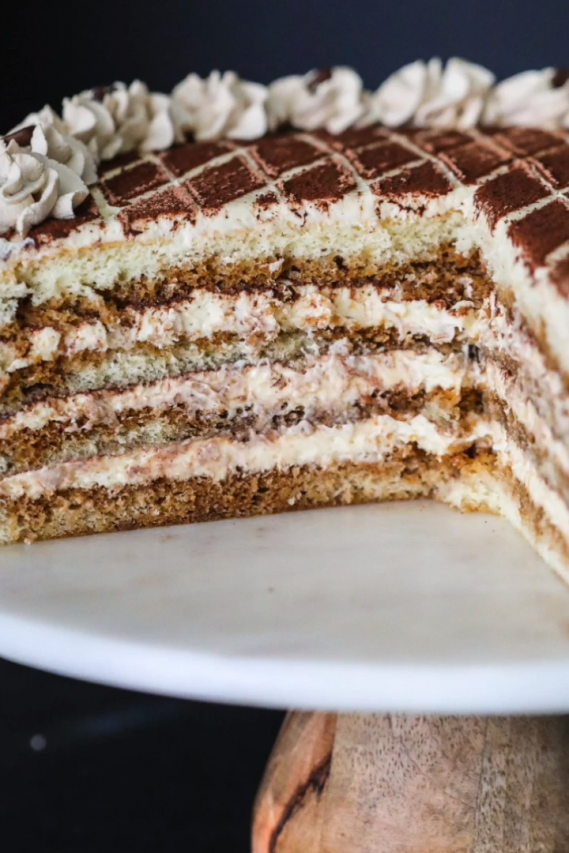 Moist sponge cake soaked in coffee liqueur and layered between a rich mascarpone based cream. This tiramisu cake is guaranteed to become a new favorite.