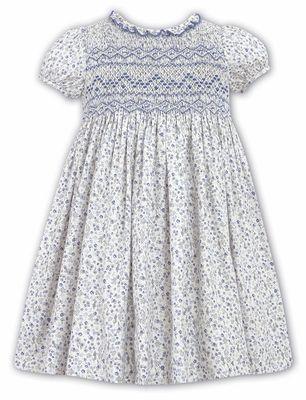 385bb965d93d Sarah Louise Girls Blue Floral Liberty Print Dress - Smocked Bodice and  Ruffle Neckline Girls Dresses