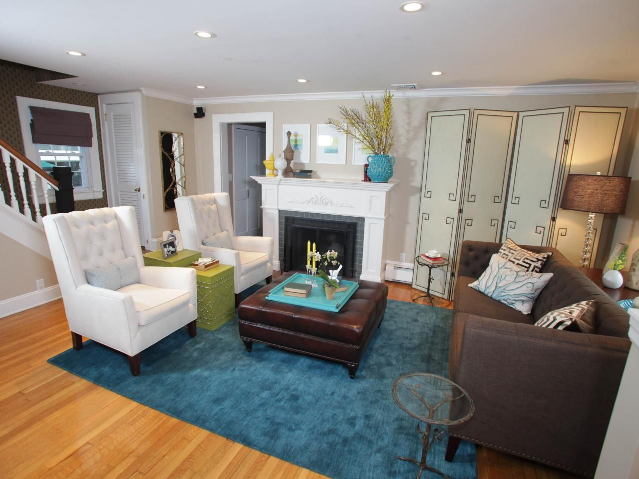 Chocolate sofa with cream walls and teal