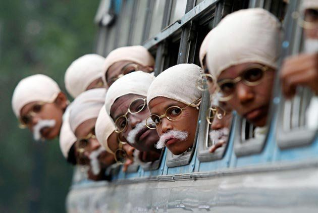 Children dressed as Mahatma Gandhi arrive on a bus to take part in a peace march in Kolkata.