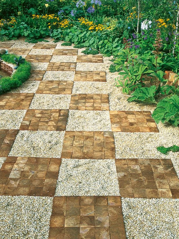Gravel and brick form checkerboard pavement design bricks for Soft landscaping ideas