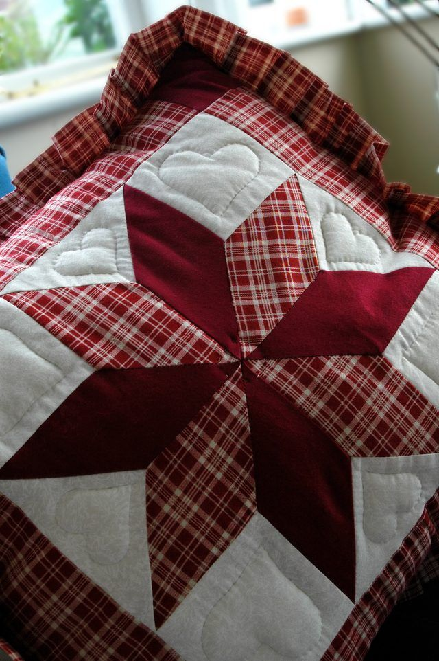 A Close Up Of An 8 Point Star Stitched On An Amish Quilt Star Quilts Quilts Doll Quilt