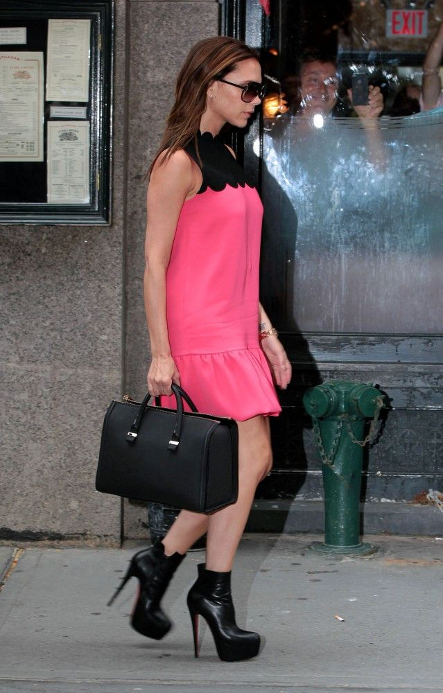 f0978ba0df4a Victoria Beckham wore a pair of mile-high ankle boots while out and about  in NYC. In her black and pink babydoll dress she was all leg.