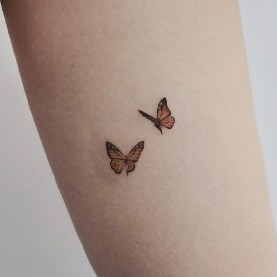 7 butterfly tattoo ankle