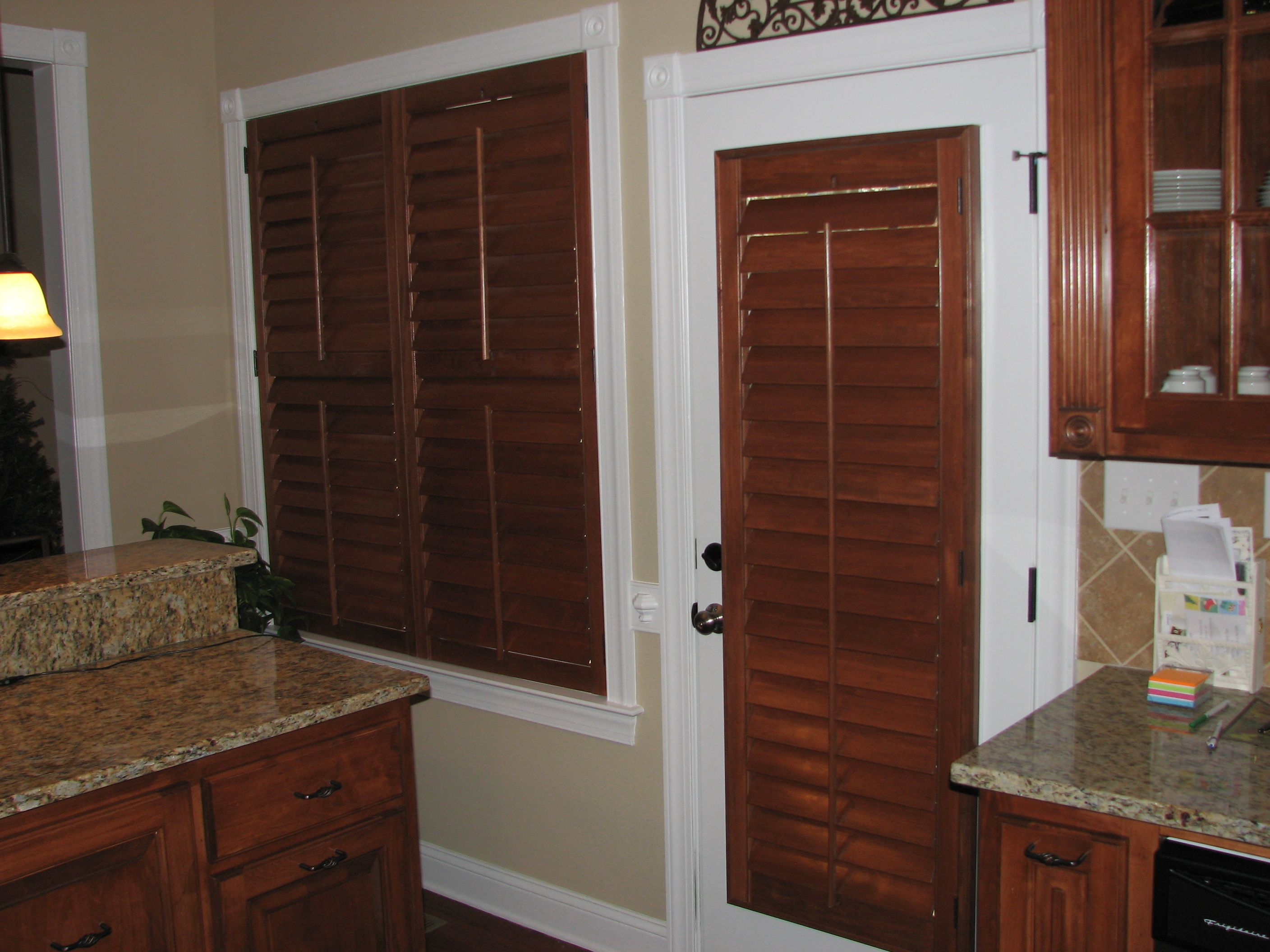 english chestnut stained plantation shutters provide a nice
