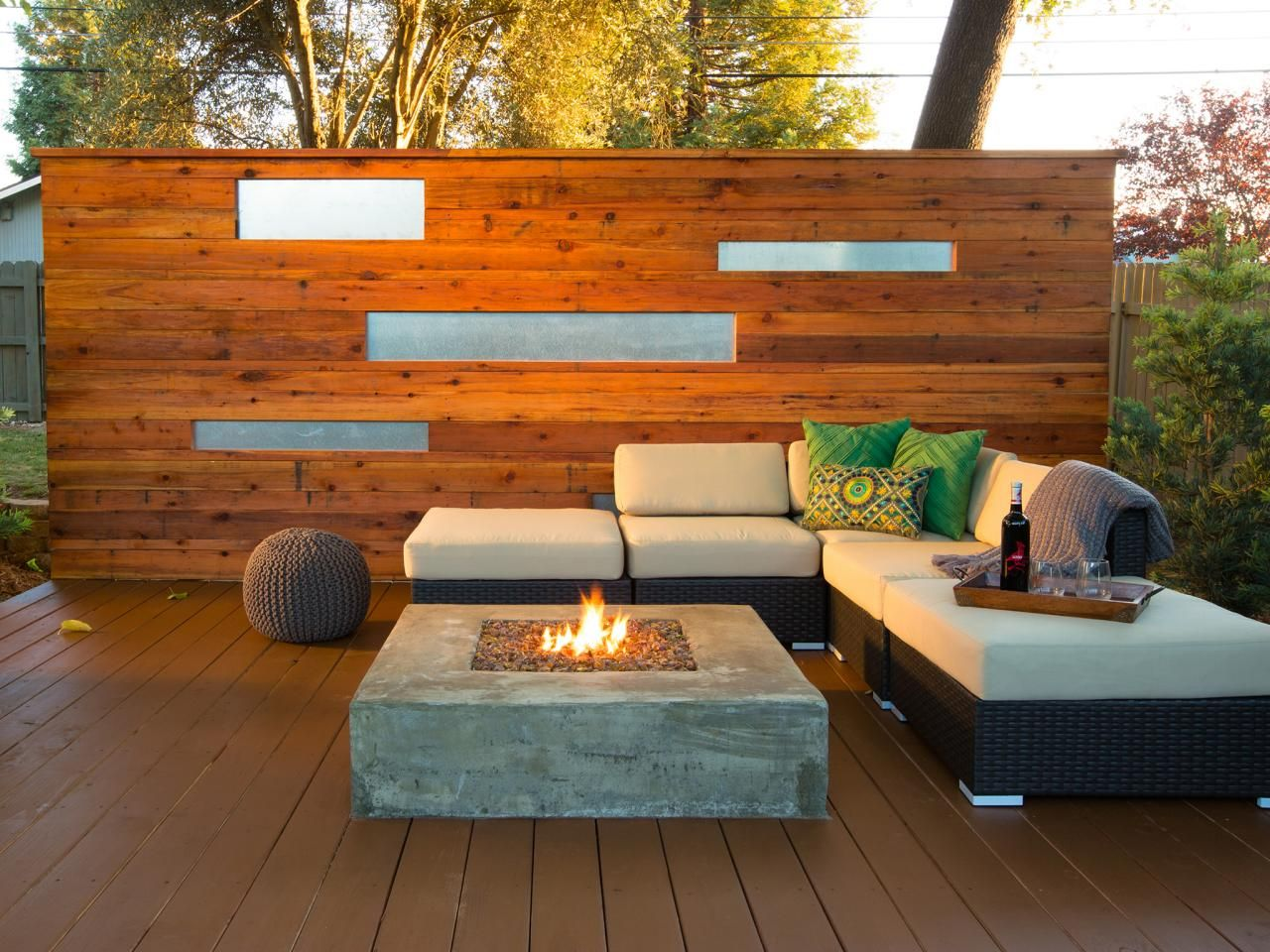 after the fire pit which sits atop a stained redwood deck and