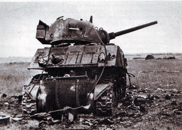 cd7b7a86e2 A destroyed Sherman  brewed up  outside Caen