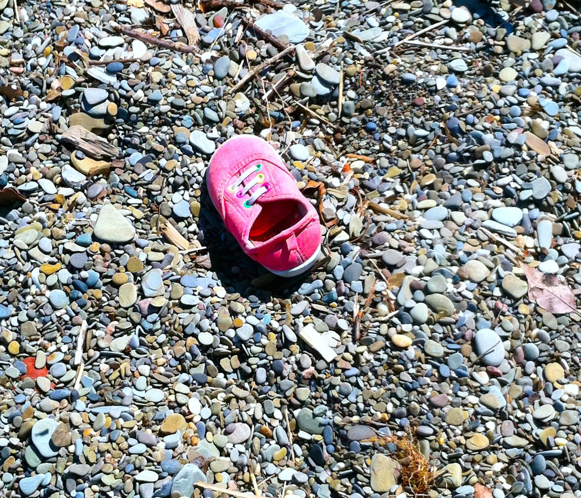 Lost shoe on beach.