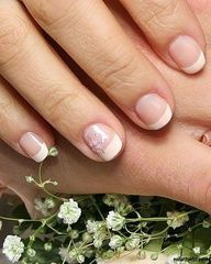 Nail art on one short French manicured nail. Many manicures with nail art are on long nails (more nail length gives you more canvas to paint on), and each nail has art affixed to or painted on it. But this photo of bridal nails shows you that could can wear nail art on short nails, and keep it simple with just one enhanced nail. Good place to start if you're new to nail art. You can experiment with one nail before you get a full set of decorated fingernails. Round pink nail tips with a…