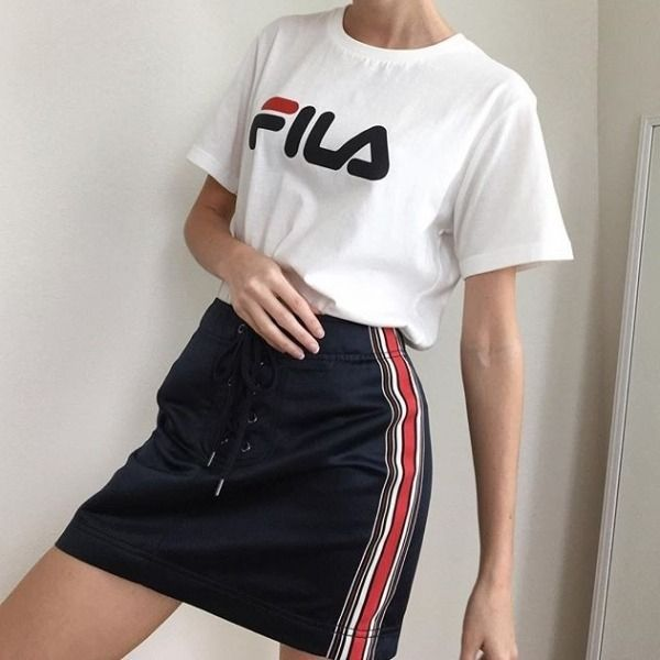 89fc4eb1f9a68 @valerie_sanders Fila White Eagle T-shirt / Silence + Noise Avril Lace-Up  Mini Skirt #UrbanOutfitters #UOEurope #UOonYou