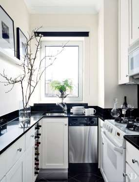 designer larry laslo updated the galley kitchen of a new york apartment with a black