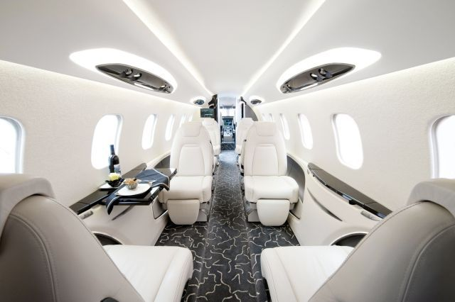 And in the air!!!  Nothing says Skinny Rich Bitch more than the white interior of a Lear jet 45!