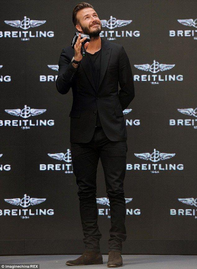 David Beckham looks dapper in a smart black suit in China ...