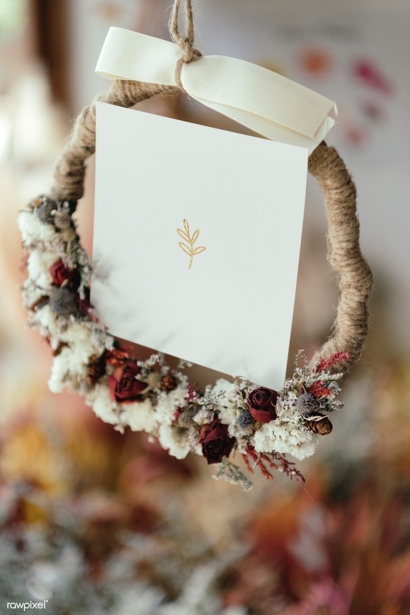 Download premium psd of Dried flowers wreath with a white