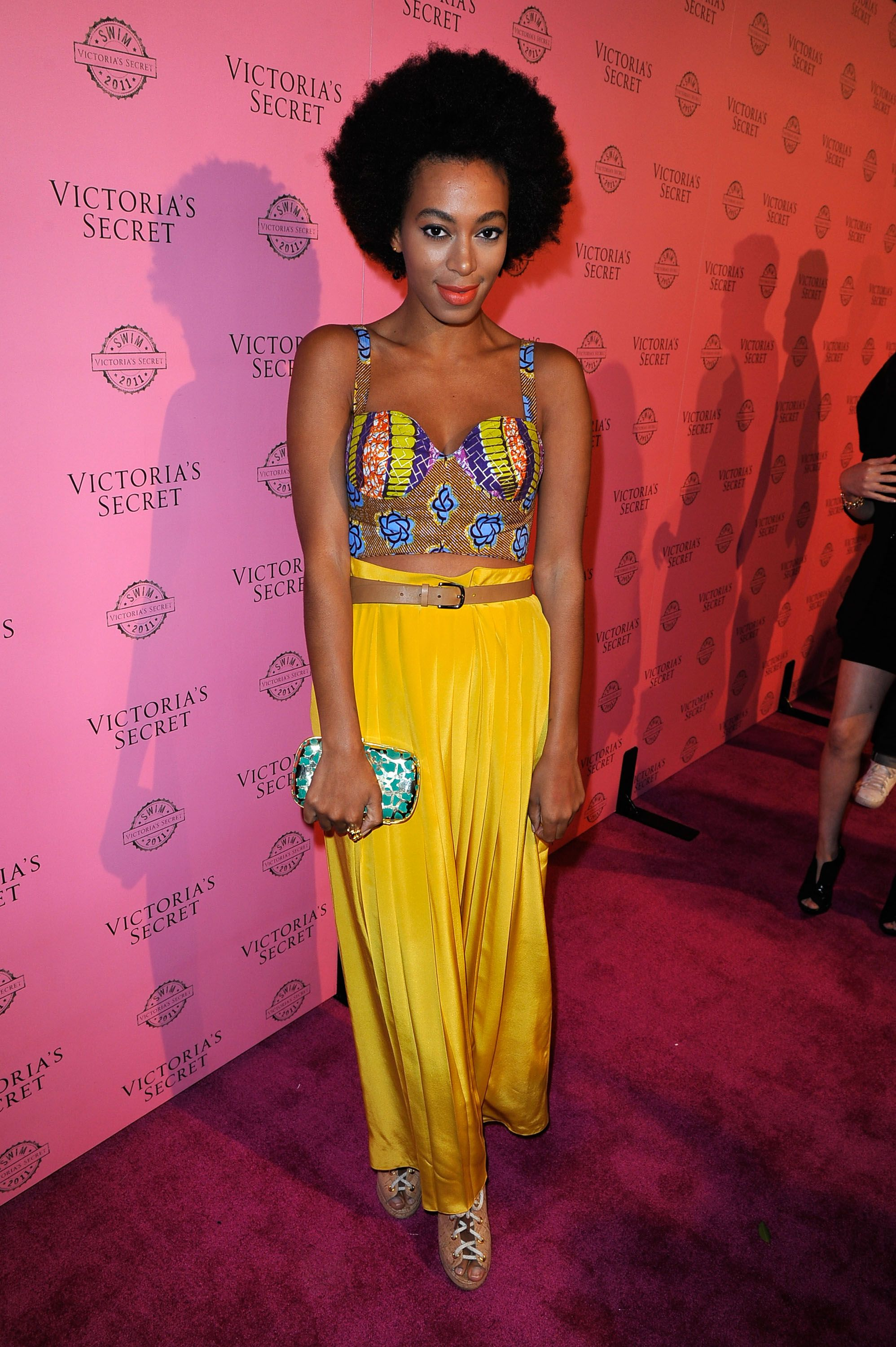 Yellow again! Solange wore a tribal crop top and high-waisted trousers for a Victoria's Secret event in Los Angeles.