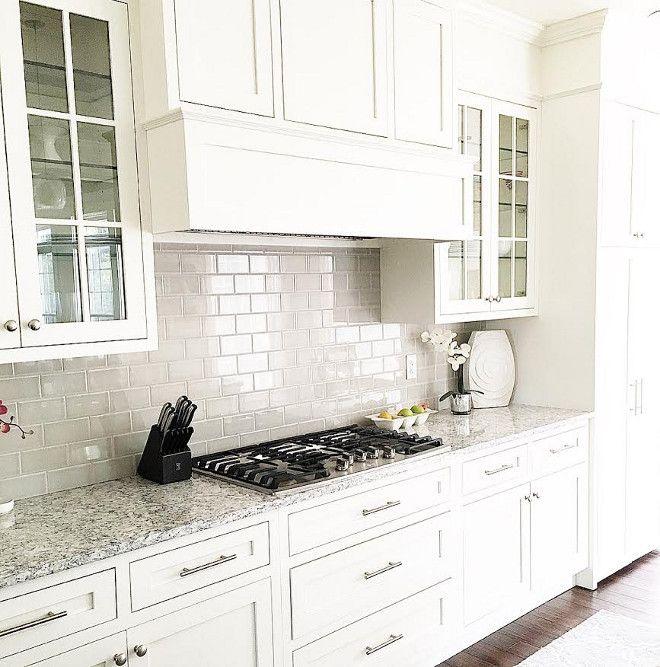 Grey backsplash tile in creamy white kitchen.   Kitchens...the heart ...