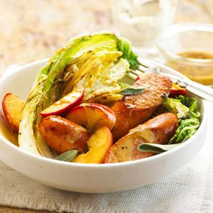 Apples and cabbage bring a new dimension to smoked bratwurst links. A sour cream mixture adds the final touch to this recipe that can be prepared in less than 30 minutes.