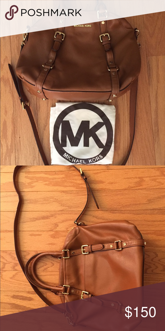 Camel colored Michael Kors bag Camel colored Michael Kors bag. Very minimal use, still has original bag that it came in. Comes with shoulder strap and Crossbody strap. Michael Kors Bags Shoulder Bags